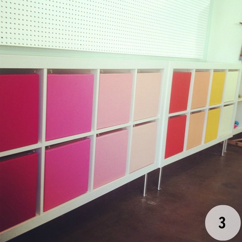 They used some coloured canvases on hinges to make doors. I love the colours!