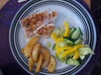 Fish, roast potato and salad.